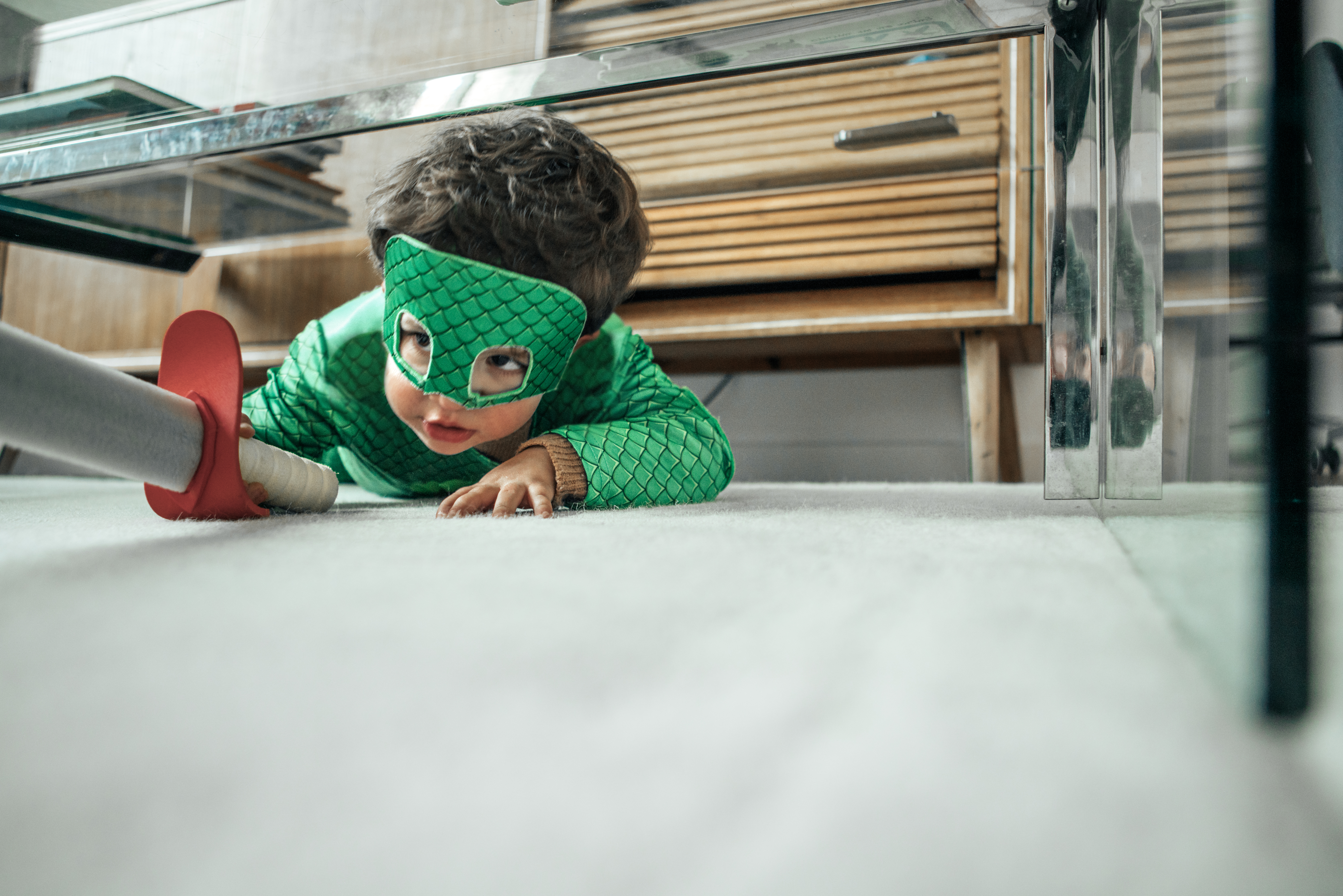 dressed up child playing under bed
